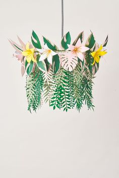 Make a botanical chandelier, cascading with tropical paper leaves and flowers.