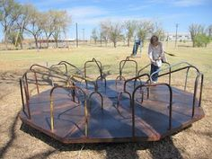 Old-style playgrounds, with actual metal playground equipment, slides, swings, see-saws, the whole shebang.