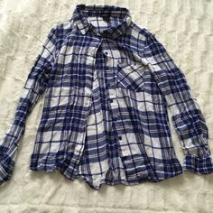 Plaid flannel Has a rip as shown in pic 2. Tag says M but fits like a small. Not from listed brand. LF Tops Button Down Shirts