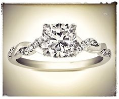 Cushion Diamond Petite twisted pave band Engagement Ring; wow.