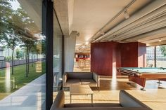 Image 19 of 43 from gallery of Maison des Etudiants / Lacroix Chessex. Photograph by Radek Brunecky Interior Architecture, Interior Design, Student House, Entrance, Building, Outdoor Decor, Table, Gallery, Furniture