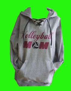 This Glitter Designed Volleyball Mom sweatshirt is a 9.5 oz. premium fleece hoodie is 80% cotton/ 20% poly is complete with a hiddencellphone pocket inside the
