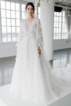 Stunning floral wedding dress with sleeves from the inimitable Marchesa and Marchesa Notte Fall 2018 bridal presentation (BridesMagazine.co.uk)