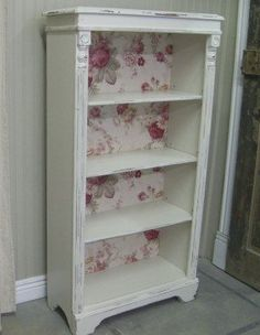 take a plain bookcase and shabby it with wallpaper and