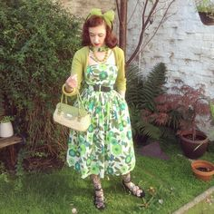 """""""When it sunny af so all your other photos are squinty  Rocking all of the greens today  Dress and bag by @tatyanaboutique 