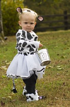 Little calf costume - shirt made by freezer paper stencilng, pants made by adding cow print cotton fabric to the bottom of a pair of too-short pants, tutu/tail from tulle and cow print fabric with a little fleece for the hair at the end of the tail.  Ears from fleece and felt attached to a cow print fabric headband with velcro on the reverse side to hold it onto her hair.  A milk pail completes the costume.