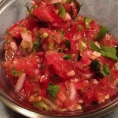 My favorite fresh salsa... 6 Roma tomatoes, 2 jalapeño peppers, 1/2 red onion, 1 bunch cilantro leaves, Garlic, Garlic salt, Lemon juice, Lime juice, Orange juice. Cut, slice, or dice veggies to desired size. Add garlic, garlic salt, and juices to taste. Super awesome summer snack!