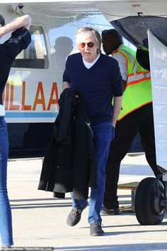 PAUL ON THE RUN: Paul McCartney boards a yacht in St Barts with wif...