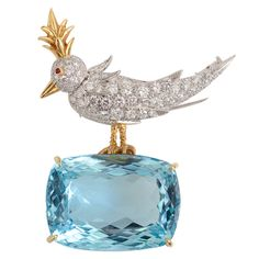 TIFFANY & CO., SCHLUMERGER, Gold & Platinum, Diamond & Aquamarine ?Bird on the Rock? Brooch. This iconic design of Tiffany & Co. is consist of 70 round diamonds weighing approximately 3.50 carats accented by a polished gold beak, head feather and legs with one small ruby eye, perched atop one cushion-shaped aquamarine approximately 46.25 carats, 18Kt and platinum; signed Tiffany & Co. Schlumberger