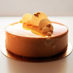 """Cake """"Caramel delight with passion fruit"""" new design. Hazelnut biscuits with pine nuts, praline with chocolate and paillete feuilletine, salted caramel, caramel creme brulee, caramel cream, exotic compote with passion fruit, caramel glaze."""