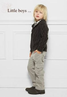 adorable little boy pose, totally loving the outfit