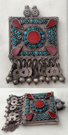 Uzbekistan | Old Turkoman pendant; silver, turquoise and carnelian.