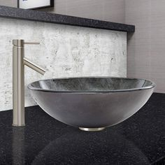 The VIGO Gray Onyx Glass Vessel Sink and Dior Faucet Set in Brushed Nickel Finish provides any bathroom with a unique and distinctive style. The VG07051 Gray Onyx glass vessel sink features a graceful and shimmering fusion of black and silver colors.