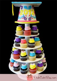 Colorful Grad Cap Cupcake Tower by Pink Cake Box in Denville, NJ.  More photos at http://blog.pinkcakebox.com/colorful-grad-cap-cupcake-tower-2012-06-20.htm  #cakes