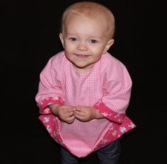 Use your old receiving blankets to make this reversible smock bib. Visit website for free PDF pattern.