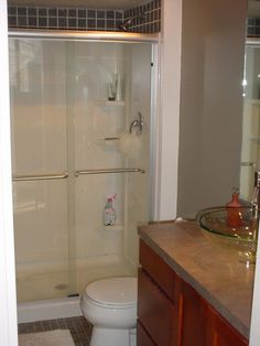 Lake St Louis condo remodel; master bathroom    Work by Architectural Elements