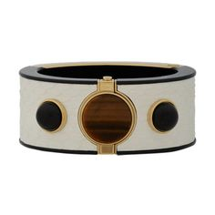 Finally an attractive wearable device's come. Opening Ceremony x Intel White Snakeskin MICA Smart Bracelet at Barneys.com