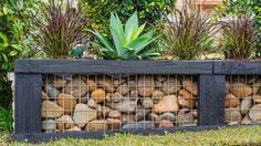 Replace an old retaining wall with a pebble filled one