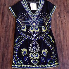 FREE PEOPLE Dress Echoing Ella Sequin Beaded Shift Size Large (Euro 42).  New with tags.  $550 Retail + Tax.   Gorgeous shift dress with embellished embroidery throughout.  Hidden side zip closure. Sheer shell, lined body.  By Antik Batik for Free People.   Viscose.  Imported.     ❗️ Please - no trades, PP, holds, or Modeling.   💰 Bundle 2+ items for a 20% discount!   👠 Stop by my closet for even more items from this brand!  ✔️ Items are priced to sell, however reasonable offers will be…