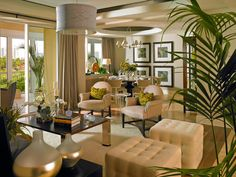 the pictures echo the stool in shape, the dining chairs echo the lamp shape...light colors keeps room bright.