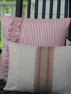 Cute red ticking pillow w/ ruffle.  Could try to include the seat burlap webbing of other pillow underneath the ruffle