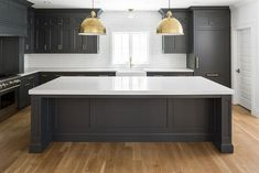 Kitchen with black cabinets, white counters, white walls, and a white backsplash. Here are 10 home design trends to expect in Best Kitchen Design, Kitchen Cabinet Design, New Kitchen, Kitchen White, Kitchen Modern, Brass Kitchen, Black And Grey Kitchen, Country Kitchen, Vintage Kitchen
