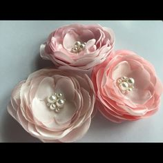 "Flower hair clips Beautiful, rich flowers in pink shades satin with pearls embroidered centers. Each flower measures about 1.5"".  You will receive 3 flowers with this listing on a clip, a pin, a headband.  Specify at checkout.  Those flowers make a timeless, elegant and rich baby accessories to wear for your christening or wedding. Wear separate or together, at the waist, on a hat, on a bag, as a brooch or in the hair. These flowers are rich yet subtle.  When checking out, be sure to list…"