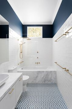 Bright bathroom in white and blue with marble bathtub . Bright bathroom in white and blue with marble bathtub design White Subway Tile Bathroom, Bathroom Floor Tiles, Bathroom Renos, Bathroom Remodeling, Bathroom Ideas White, Black And White Bathroom Floor, Metro Tiles Bathroom, Blue White Bathrooms, Tiled Bathrooms