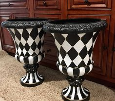 This is s pure black and white harlequin version of my urn planter. Stately. Regal. Trimmed in gold leaf, this planter is perfect for your tasteful space. Classic updated look. Each urn is molded from fiberglass and cast resin. Treated with two durable topcoats of polyurethane, its finished with a glossy and gorgeous shine. This is a large size piece measuring 24 inches tall and 15 inches across. How about one for each side of your front door? Pool area, deck or cottage? Perfect for indoor…