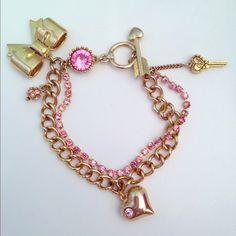 Betsey Johnson gold pink rhinestone bow bracelet Betsey Johnson. Gold colored bow and pink rhinestone chain bracelet. Loop and plank clasp. #pink #bows #bow #bracelet #cutesy #adorable #girly #pinup #vintage #betseyjohnson #pinkbowsandbling…