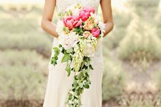 Wedding bouquets are moving towards a looser, more whimsical, romantic vibe. Cascade bouquets are coming back! You might associate cascade (trailing) bouquets with the 80s or 90s, but in fact, they are one of the hottest wedding trends now.  Most cascade bouquets use a variety of flowers from large or hanging foliage, creating the gorgeous …