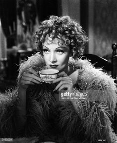 Marlene Dietrich sips a cup of tea in a scene from the film 'Destry Rides Again' directed by George Marshall Golden Age Of Hollywood, Vintage Hollywood, Hollywood Stars, Classic Hollywood, Marlene Dietrich, The Blonde Salad, People Drinking Coffee, Drinking Tea, Annie Leibovitz