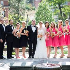 Grooms woman wear color of dress coordinating with suit bridesmaids wear different color.