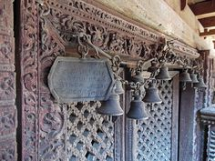 Ornate carvings and bells at a Buddhist temple in Bhaktapur, Kathmandu valley