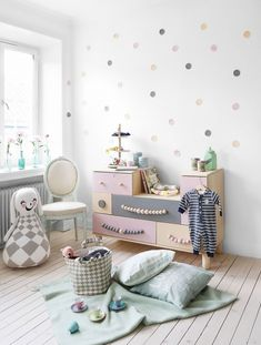 The IKEA aesthetic is typically modern and sleek, so we were surprised to discover one of the items in this feminine playroom is from the label. Can you spot it? The pastel wooden dresser is the...