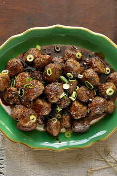 Set these juicy turkey meatballs out on a platter, drizzle with a ginger-spiked sauce of soy, mirin and dark brown sugar and serve with toothpicks alongside wine or cocktails. They'll go quickly. (Photo: Michael Kraus for NYT)