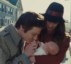 American Hustle (2013)   The baby is JR's daughter Ava. And yes, that's his wife holding their baby.