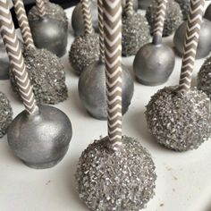 Love this look! Metallic Cake Pops Displayed on Gray Chevron Straws