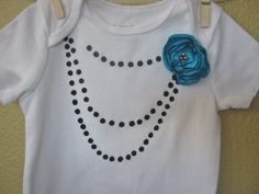 String of pearls onesie with turquoise shabby-chic satin flower on Etsy. $14