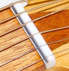 the bone at the neck Guitar Diy, Guitar Shop, Guitar Chords, Guitar Supplies, Cigar Box Nation, Classical Acoustic Guitar, Homemade Instruments, Guitar Neck, Cigar Box Guitar