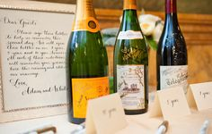 Guest book goes creative—sign bottles Champagne or wine
