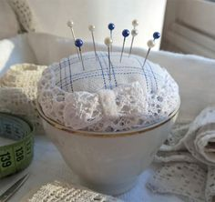Pincushion on a vintage coffee cup