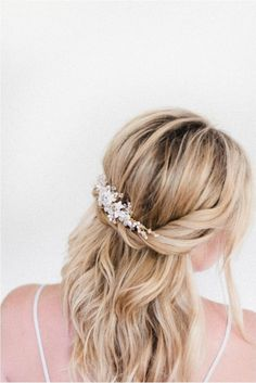 If you're looking for an airy, ethereal look on your big day, try this half-up look from Molly and Joanna of Irrelephant. Start with curled or wavy hair. Twist the section right above each ear back to the center of the head, and pin into place. Leave it like that, or use a gorgeous headpiece to add some sparkle.