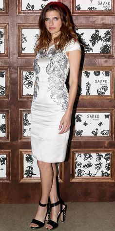 Lake Bell gave her pretty iris-embroidered cap-sleeved Temperley London sheath some edge with a pair of heel-studded ankle-strap sandals.