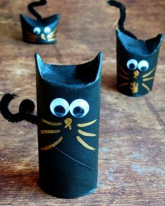 halloween crafts for kids from reused toilet paper rolls as black cats with googly eyes decoration