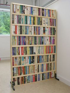 Book Partition by Lula Dot: Made of recycled paper backs. #Room_Divider #Book #Paperback #Lula_Dot