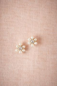 Sea Flora Posts | With pearl petals and crystallized centers, these simple studs make a great thank-you for the maids. #mwbridalstyle #bhldnbride