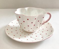 Wonderful vintage Shelley dainty pink polka dot bone china tea cup and saucer made in England. It is in good condition, no chips, cracks or crazing. Please Note: The items I sell are not new, they are vintage or antiques, it goes without saying that there maybe some imperfections