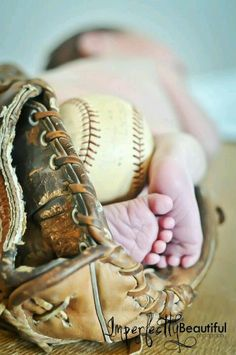 Baby feet and baseball. Cute idea if this was the nursery theme! :)