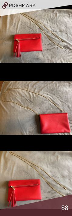 Little red bag with tassel detail. Wear this little red bag as a stylish cross body with the optional gold chain strap or as sassy clutch for a night out. Used once. street level Bags Crossbody Bags
